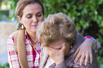 hourglass older person being comforted